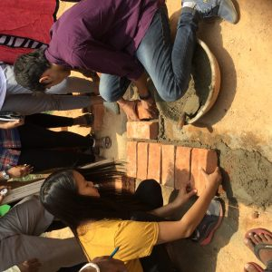 Students at hands-on workshop in Construction Yard